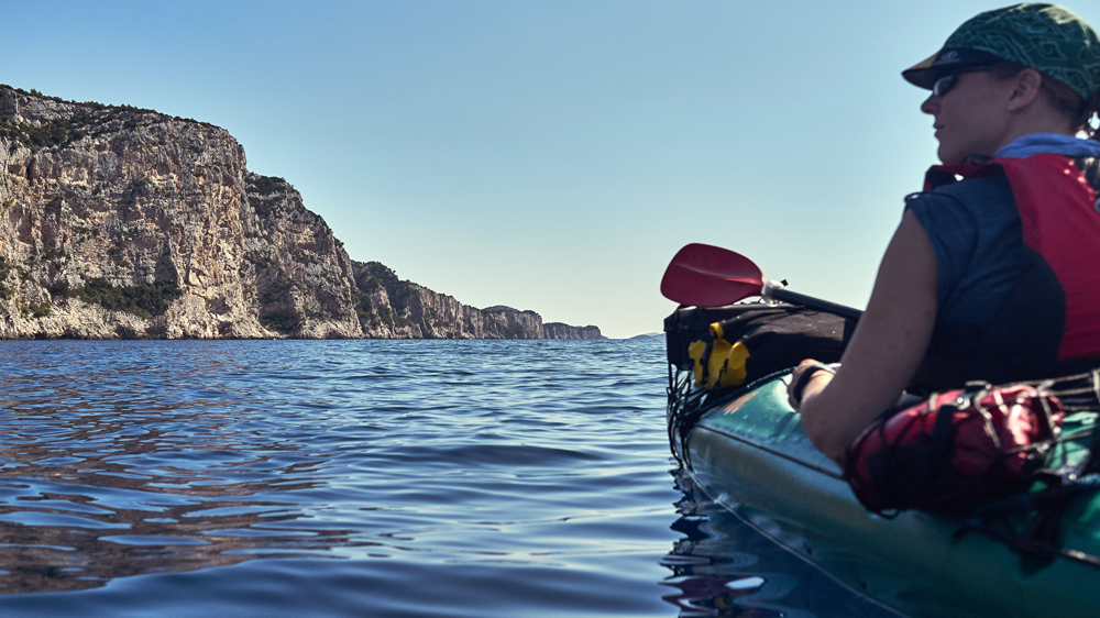 huge cliffs and a calm sea that's all you need when paddling in Croatia