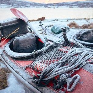 Paddling beyond the Arctic Circle frozen kayaks in the morning