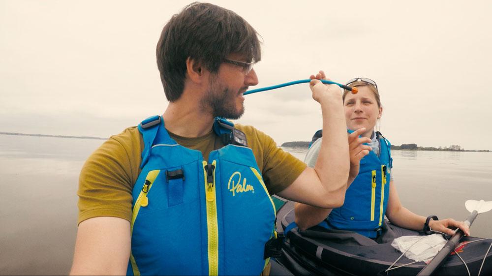 sharing water in a Kayak
